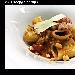 -Paccheri Freschi di Grano Senator Cappelli in amalgama di Pachino, Bisque di Crostacei, Concassée di Melanzane, Tartare di Pesce Spada e Lamella di Pecorino Canestrato di Moliterno.