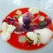 Polpo al thè di lamponi su coulis di pomodorino, gelatina di cetriolo, spugna all