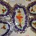 Carpaccio di baccalà agli agrumi e patate viola