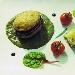 Merluzzo in crosta, torretta di patate e melanzane su vellutata al basilico