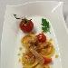 Ravioli di pasta fresca  con ripieno all'amatriciana, pomodorini appassiti e pesto di prezzemolo al pecorino